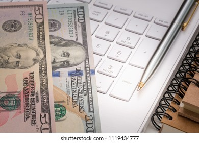 Dollar banknote with pen and keyboard for business concept