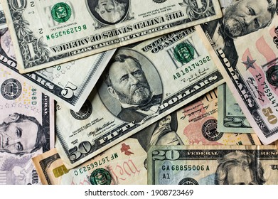 Dollar banknotes of different denominations. Money background.