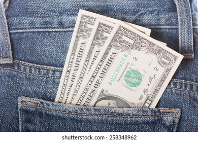 Dollar banknotes in the jeans pocket