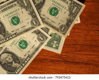 Dollar banknotes money (USD), currency of United States on wooden desk with copy space