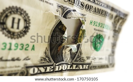 a dollar bill with a torn hole in the center