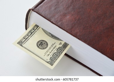 Dollar bill used as a bookmark in a book