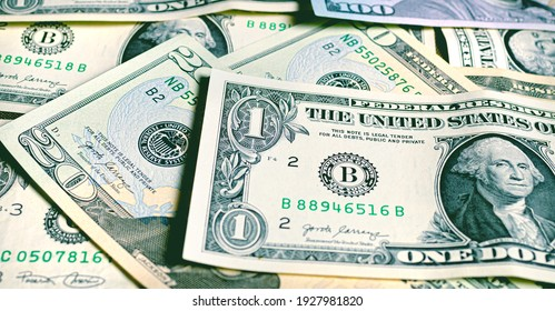 Dollar bills background in vintage style color tint. Highlight for the dollar bill. Money, Us currency ( USD ).
