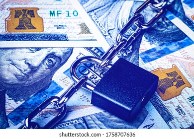 Dollar bills, black lock and metal chain. Money lock or security concept. Account lockout.