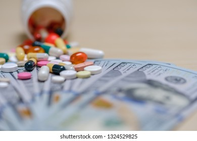 Dollar bills and colored pills on a light background. Tablets money concept.