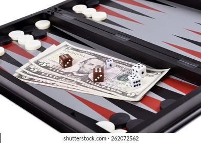 Dollar bills with dice on the   backgammon