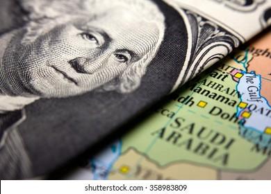 Dollar bills (figuring George Washington) on top of a map of Arabia