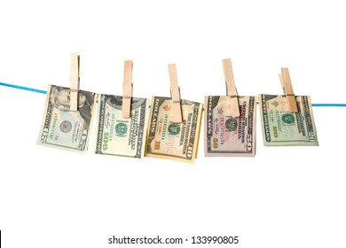 Dollar bills hanging on a rope with wooden pegs  isolated on white