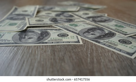 dollar bills lying on the grey laminate.