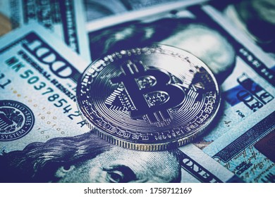 Dollar bills and metal souvenir bitcoin. The concept of electronic money and commerce. Cryptocurrency and cash.
