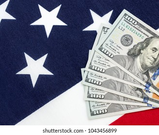 Dollar bills on the american flag. Top view. Copy space.