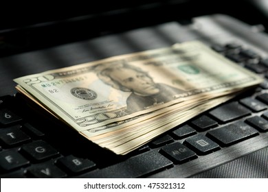Dollar bills on a laptop