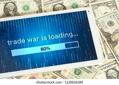Dollar bills, Tablet PC and Trade War