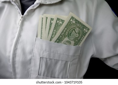 Dollar bills in white shirt pocket for saving and investment concept