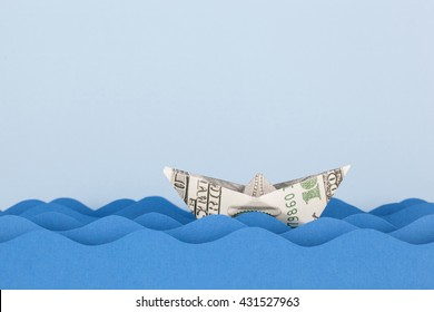Dollar boat swimming on paper waves