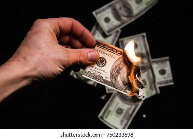 Dollar burns in his hands