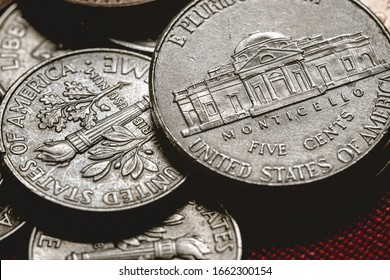 Dollar coins, Us Coins, American coins, Cents. Group of Coins on a table with red surface.