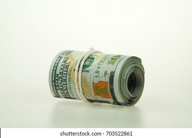 Dollar currency. Dollar banknotes rolled in other positions