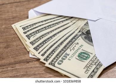 dollar in envelope on desk. savings concept.
