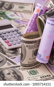 Dollar, euro banknotes, calculator
