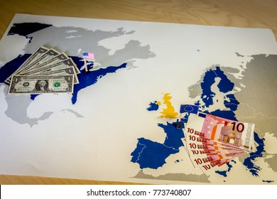 Dollar and euro,american and European flags over EU and US map,symbolizing the Transatlantic Trade and Investment Partnership or TTIP,with the aim of promoting trade and multilateral economic growth