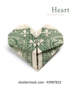 Dollar folded into heart on the white background