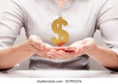 Dollar in the hands (concept)
