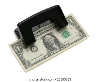 Dollar in the hole punch isolated on white.