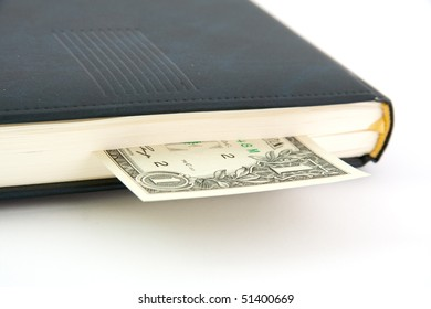 Dollar invested in the diary as a bookmark