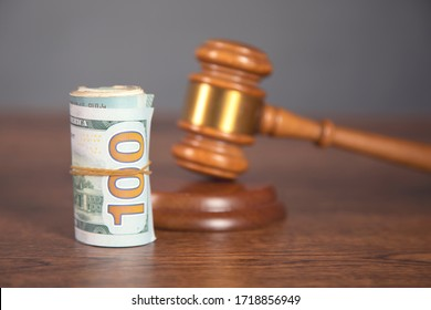 dollar and judge on the wooden table
