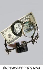 Dollar ,Magnifying Glass