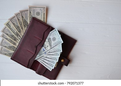 Dollar money banknotes and wallet on the white wooden background. American currency. Money Background. United states dollar.