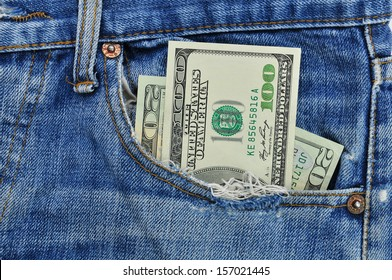 dollar note in the jeans pocket