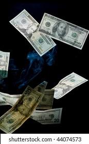 Dollar on black background with smoke
