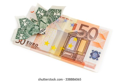 Dollar origami butterfly sits on 50 euro banknote isolated on white background. Concept of two leading hard currencies - US Dollar versus Euro