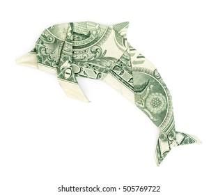 Dollar origami dolphin isolated on white background. Moneygami.