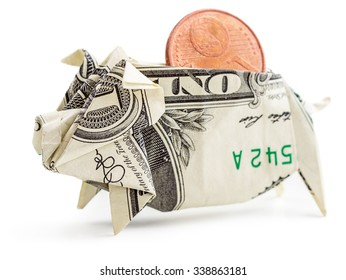 Dollar origami piggy bank with coin isolated on white background. Moneygami.