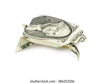 Dollar origami turtle isolated on white background