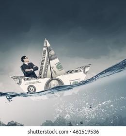 Dollar paper boat . Mixed media