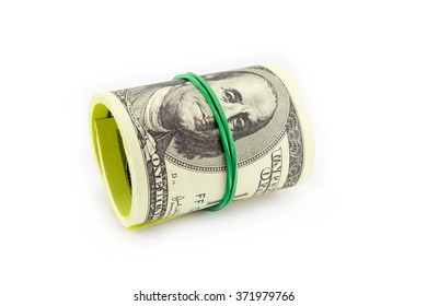 Dollar roll tightened with band. Rolled money isolated on white