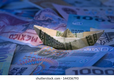 Dollar ship floating in money sea