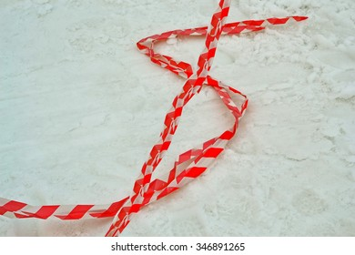 dollar sign from red stripped pvc cord on the snow, modern security details