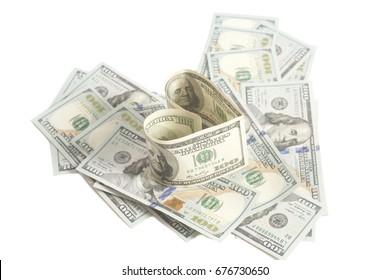 Dollar US bills in heart shape on white background