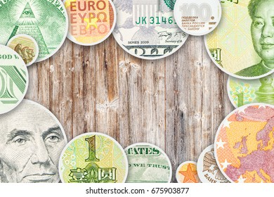 dollar, yuan, euro and ruble collage in circle form images on wooden background