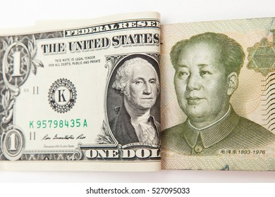 dollar and yuan on white backgrounds