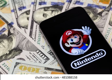 Dollars, Apple iPhone 6s with Super Mario Bros figure character from Super Mario video game console developed by Nintendo EAD. Ekaterinburg, Russia - September 9, 2016