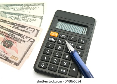 dollars banknotes, calculator and pen on white