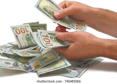 Dollars banknotes in hand on white background