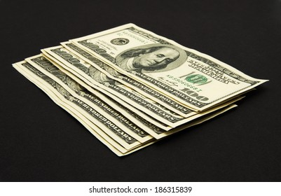 Dollars banknotes isolated on black background.