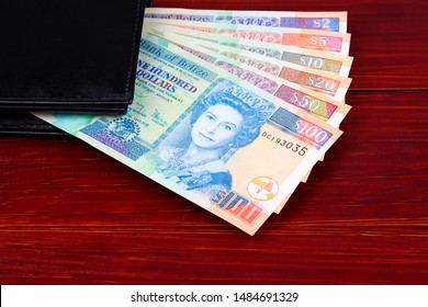 Dollars from Belize in the black wallet